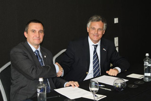 WDCS CEO, Chris Butler-Stroud signs the agreement with Eduardo Quesada, President of the IJEC.